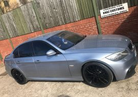 BMW Window tints and black powdercoated wheels